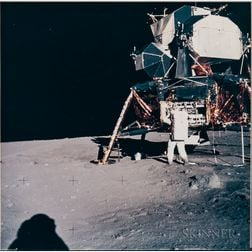 Apollo 11, Astronaut Edwin E. Aldrin Jr. Removing the Seismometer Experiment from the Scientific Equipment Bay (NASA AS11-40-5928...