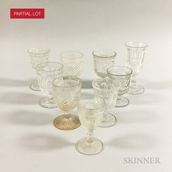 Approximately Seventy-five Colorless Pressed Glass Wines