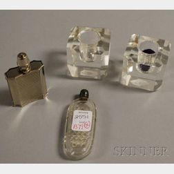Myloder Cigarette Lighter, a Colorless Cut Glass Perfume Vial, and a Pair of Small Colorless Cube Candleholders.
