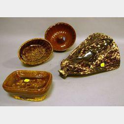 Bennington Glazed Stoneware Footwarmer, a Rockingham Glazed Stoneware Soap Dish and Mold, and a Redware Mold.