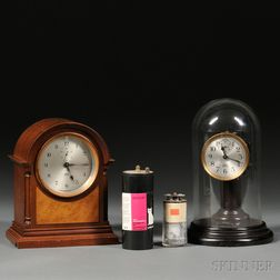 Two Poole Electric Clocks