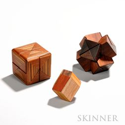 Stewart T. Coffin (American, b. 1931)  Three Wooden Puzzles: Diagonal Cube, c. 1971-1985, design no. 58, zebrawood and teak, ht. 3 in.;
