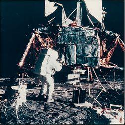 Apollo 12, Astronaut Alan L. Bean Unpacking Experiments at the Lunar Module (NASA AS12-46-6787), November 19, 1969.