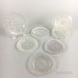 Seven Sandwich Colorless Pressed Glass Cup Plates