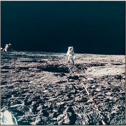 Apollo 12, Astronaut Alan L. Bean Deploying the Three-arm Lunar Surface Magnetometer (LSM) (NASA AS12-46-6813), November 19, 1969.