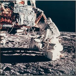 Apollo 12, Astronaut Alan L. Bean Unloads Apollo Lunar Surface Experiment Package (ALSEP) Radioisotope Thermoelectric Generator (...