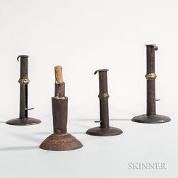 Three Brass-banded Iron Hogscraper Candlesticks and an Iron Make-do Candlestick