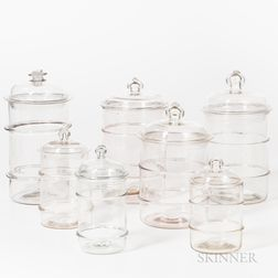 Seven Blown Colorless Glass Food Jars
