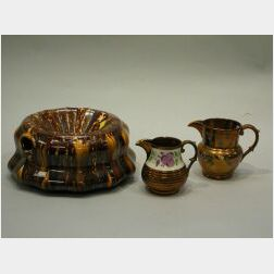 Bennington Glazed Spittoon and Two Copper Lustre Pitchers.