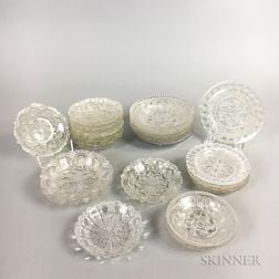 Twenty-six Sandwich Colorless Lacy Pressed Glass Cup Plates.     Estimate $200-300