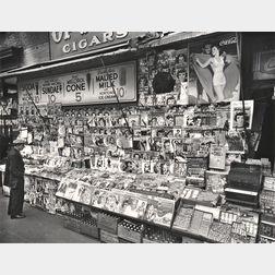 Berenice Abbott (American, 1898-1991)      Newsstand, 32nd Street and Third Avenue, Manhattan
