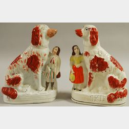 Pair of English Staffordshire Seated Spaniels Figures with Boy and Girl