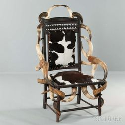 Cowhide-upholstered Carved Walnut and Horn Chair