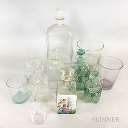 Eleven Aqua and Colorless Blown Glass Decanters, Bottles, and Tumblers