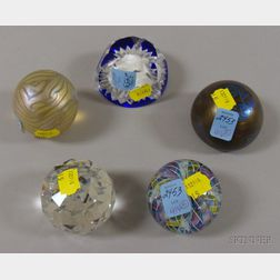 Five Internally Decorated and Colorless Glass Paperweights