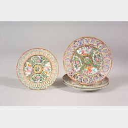 Four  Chinese Export Porcelain Plates with Openwork Rim Borders