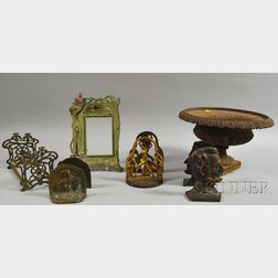 Eight Early 20th Century Cast Metal Table and Desk Items and a Cast Iron Garden   Planter