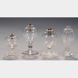 Four Small Colorless Blown Glass Fluid Lamps