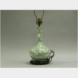 Celadon Porcelain Bottle-form Vase, China, late 19th century, pale green ground with white pate-sur-pate decorated foliage, ht. 12 in.;