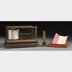 Taylor Instrument Barograph and a Three-Power Compound Microscope