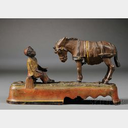 "Painted Cast Iron Mechanical ""I Always Did 'Spise A Mule Mechanical Bank,"""