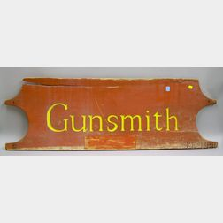 "Carved and Painted Wooden Headboard ""Gunsmith"" Trade Sign"