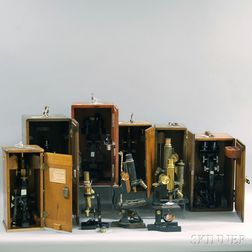 Nine Modern Microscopes in Wooden Boxes