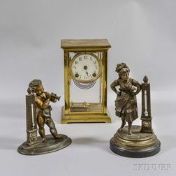 Two Victorian Base Metal Figural Thermometers and a Crystal Regulator