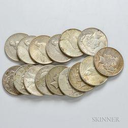 Twenty-one Peace Dollars.     Estimate $200-400