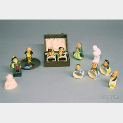 Four Royal Doulton Ceramic Dickens Figures and a Set of Eight Royal Doulton   Porcelain Dickens Character Napkin Rings