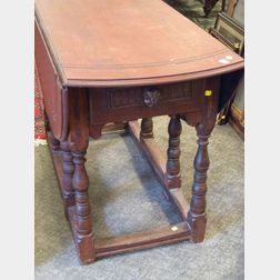 William & Mary Style Red Stained Birch, Maple, and Mahogany Drop-leaf Gate-leg Table