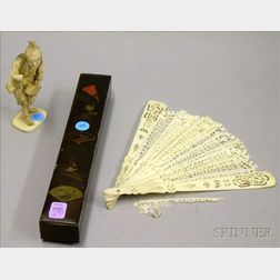 Japanese Lacquer Cased Carved Ivory Hand Fan and a Japanese Carved Ivory Figure of a   Man