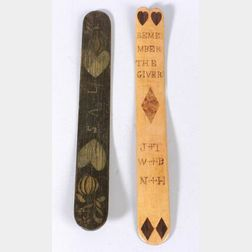 Two Decorated Wooden Busks