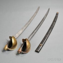 Two Model 1860 Naval Cutlasses, One with Scabbard