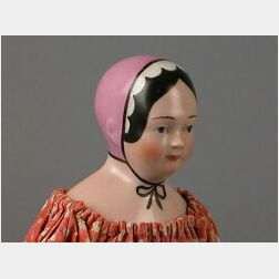 Pink-Tinted China Head Doll with Molded Pink-Lavender Bonnet