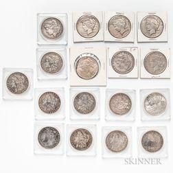 Seventeen Common Date Morgan and Peace Dollars.     Estimate $200-400