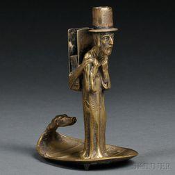 Austrian Bronze Candlestick and Match Holder of a Wandering Jew