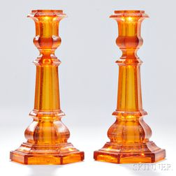 Pair of Light Amber Pressed Glass Columnar Candlesticks