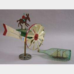 Painted Wood and Sheet Metal Jockey and Mule Whirligig and a Painted Wood and Cloth   Sailing Ship in an Aqua Glass Bottle