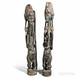 Pair of Carved Male and Female Guardian Figures