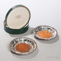 Pair of Dutch .934 Silver-mounted Wine Coasters, Amsterdam, c. 1853, makers mark WH, with a burlwood base, dia. 6 1/2 in.