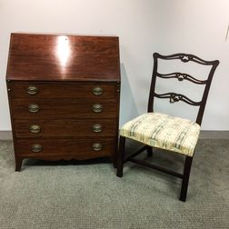 Chippendale-style Mahogany Chair and a Federal-style Irving and Casson Mahogany Slant-lid Desk.     Estimate $200-300