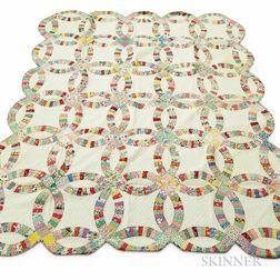 Four Patchwork Printed Cotton Quilts.     Estimate $400-600