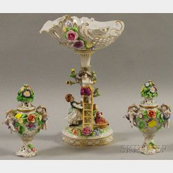 Dresden Porcelain Encrusted and Figural Centerpiece and a Pair of Cache Pots