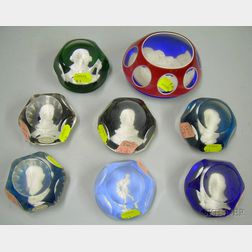 Seven Baccarat Faceted Art Glass Sulfide Paperweights and a Similar Glass Sulfide   Paperweight