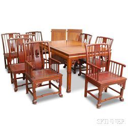 Chinese-style Carved Hardwood Dining Table and Eight Chairs.     Estimate $20-200