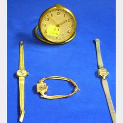 Three Gold Lady's Wristwatches and a Grant A. Peacock Travel Alarm Clock
