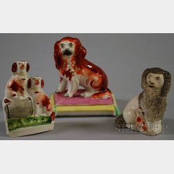Three Small Staffordshire Pottery Spaniel Figures