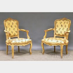Pair of Louis XV-style Creme-painted Carved Beechwood and Needlepoint Upholstered Fauteuil.