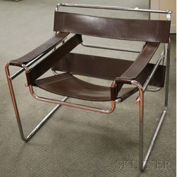 Wassily-style Brown Leather Upholstered Bent Tubular Steel Armchair.